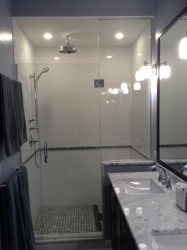 Opening the door from the master bedroom allowed for a large custom shower with bench, double vanity and great lighting.