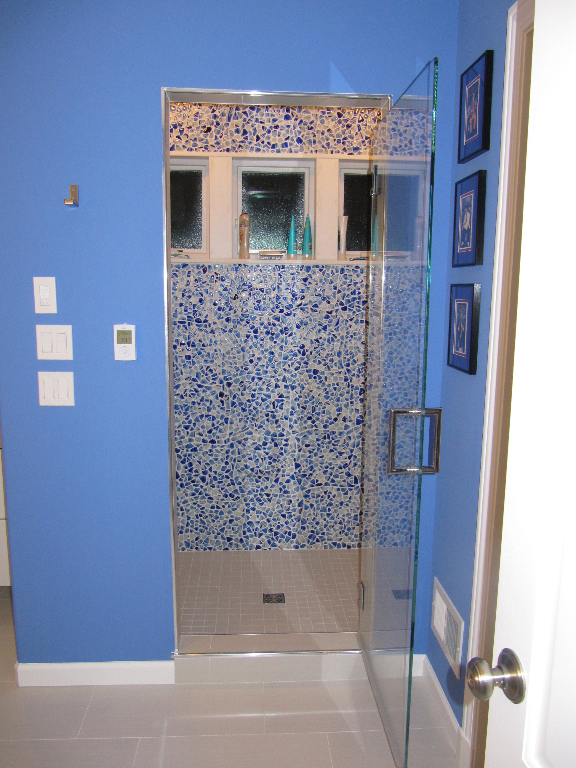 The paint color for this dramatic master bath came from the cobalt ...