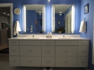 Double sink vanity, electric behind the vanity so hairdryers/razer can stay plugged in and out of sight. Lower center drawers pull out for trash.