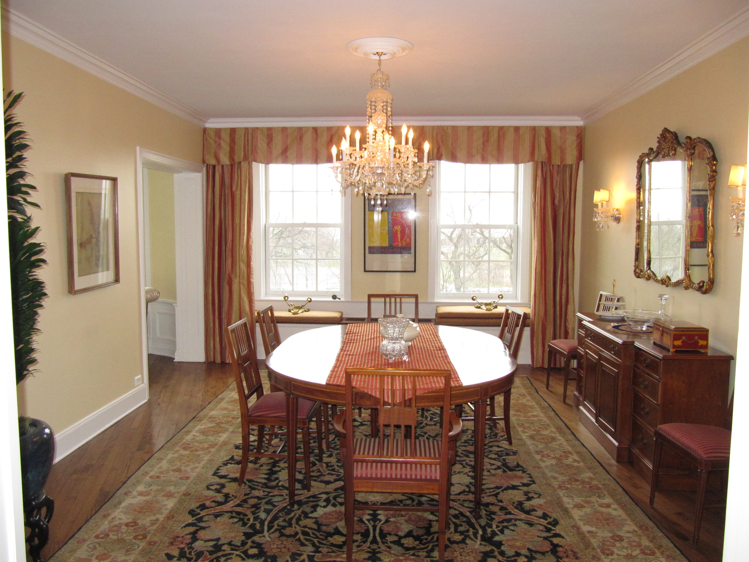 Silk Striped Draperies With A Pleated Valance Above And Window Seat Cushions Make This An Inviting Dining Room Amenities Home Design