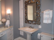 Silver gilt mirror adds pizzazz to a classic bathroom.