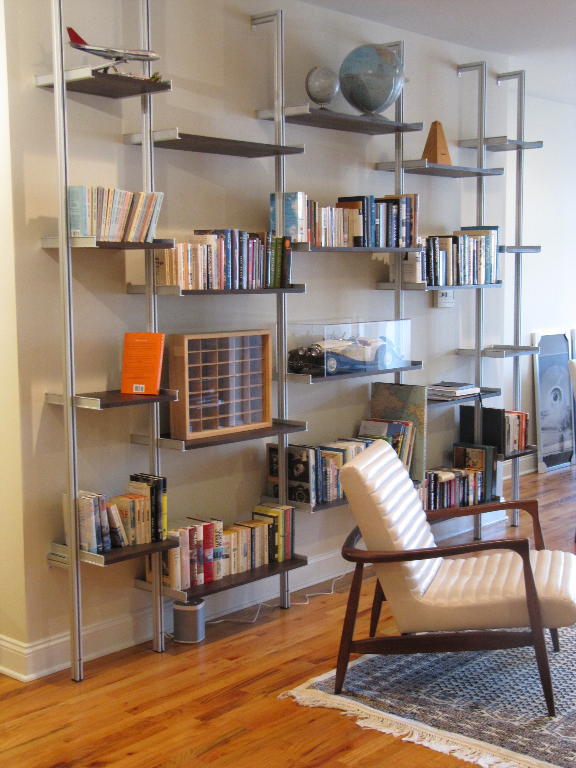 A Custom Midcentury Modern Bookcase Separates The Living