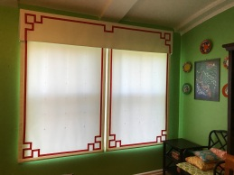 Custom Chinoiserie roman shades under a single valance.